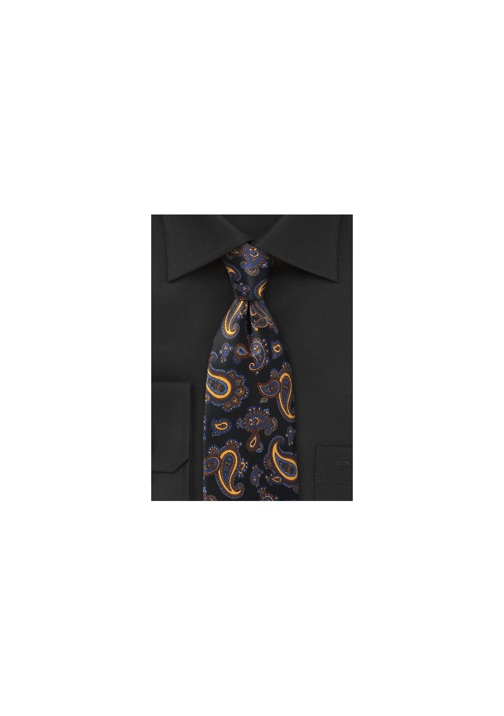 Elegant Paisley Tie in Blacks, Blues and Golds