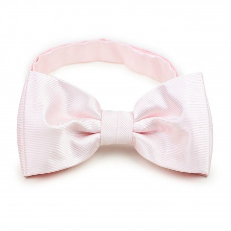 blush bow tie with ribbed texture