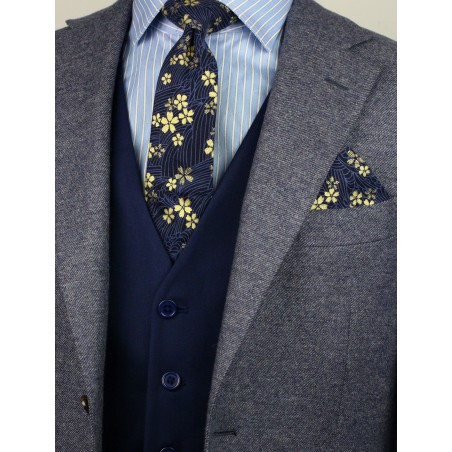 navy and metallic gold slim cut mens necktie with flower designs