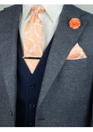 Matching peach paisley necktie and pocket square