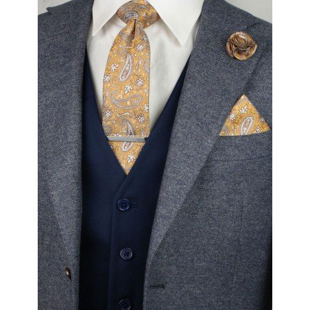 Matching caramel paisley necktie and pocket square