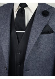 Matching black paisley necktie and pocket square