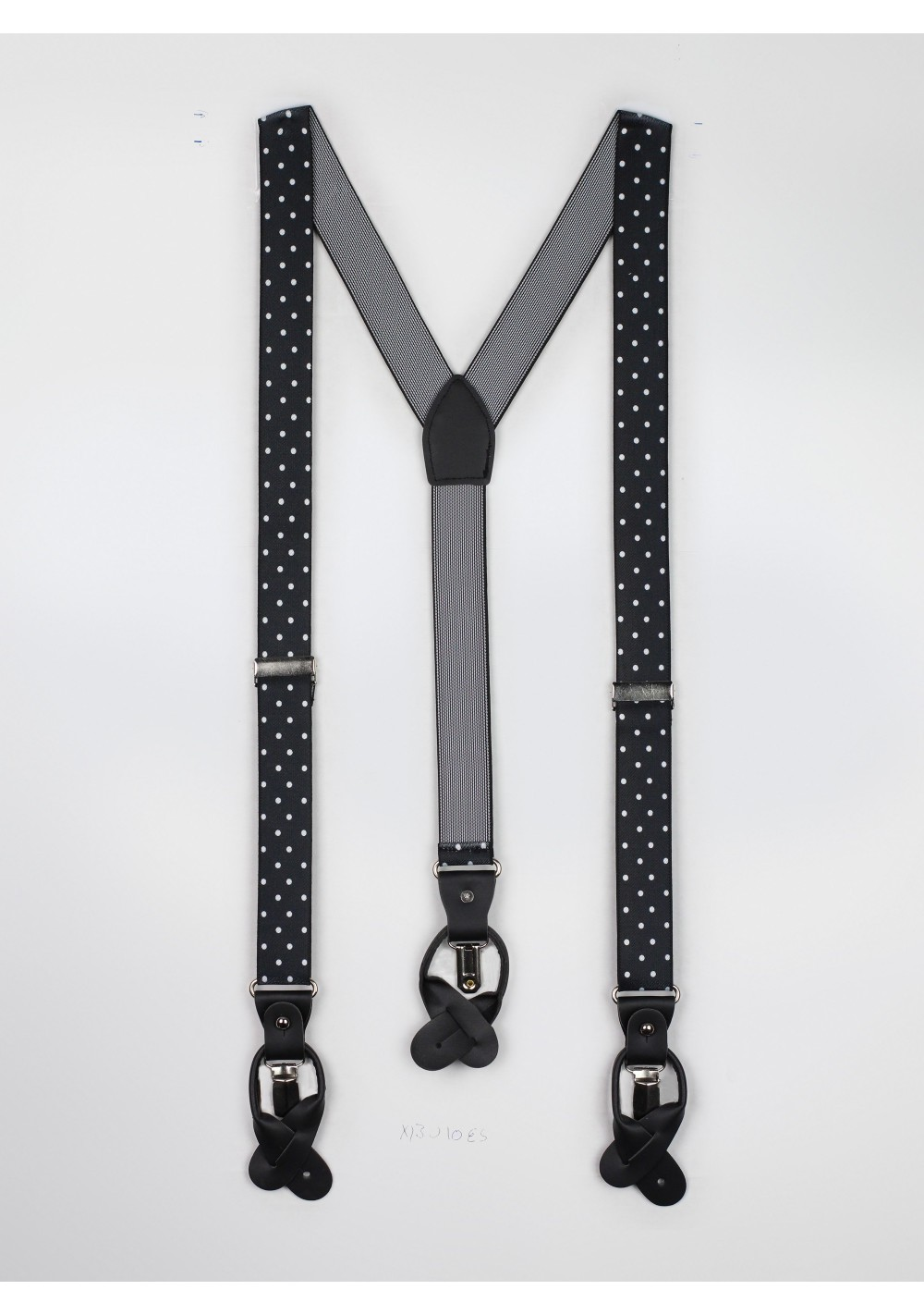 black suspenders with large white polka dots