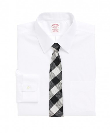 white shirt with large plaid skinny tie