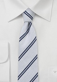 Trendy Skinny Summer Tie in Silver with Navy Stripes